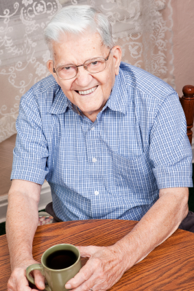 Elderly Man waring Bar Retained Supported Dentures from BiteLock.