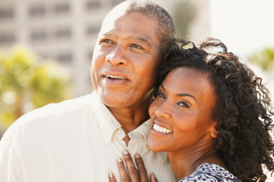 Man and woman smiling about dental implants in Irving,TX